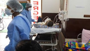 Covid Patient Administering Oxygen in Indian Hospital